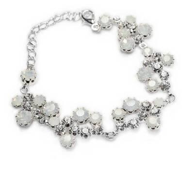 Bransoletki ślubne z białymi kryształami, występują tutaj kryształy, które idealnie komponują się z sukniami ślubnymi.