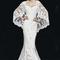 Vestido de novia 2013 con corte sirena, falda amplia con cauda y chaqueta a juego confeccionada con encaje