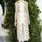 Vestido de novia 2014 Delpozo con silueta recta, falda midi, detalle de transparencia al frente, mangas cortas y estampados multicolor inspirados en las flores