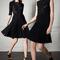 Vestidos de fiesta 2014 en color negro con detalles de encaje y plisados en las faldas