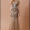 Vestido de novia con textil brocado, silueta trompeta, mangas cortas y apliques para Pre Fall 2014 - Foto Badgley Mischka