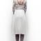 Vestido de novia con falda elegante, escote en la espalda y delicadas confecciones con encaje
