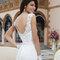 Suknia ślubna z elementami koronki i odkrytymi plecami, Foto: Sincerity Bridal 2015