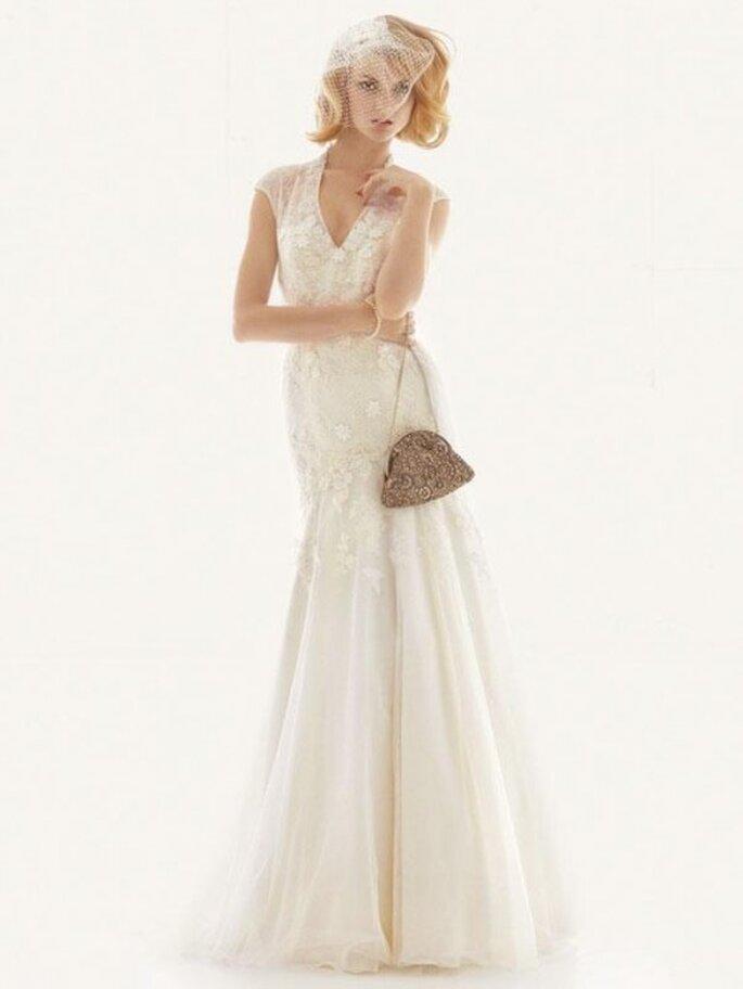 Vestido de novia elegante con encaje en mangas y falda - Foto David's Bridal