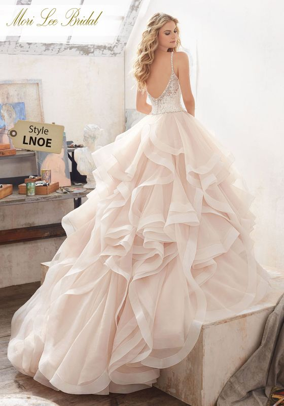 Dress style LNOE Marilyn Wedding Dress  Available in Three Lengths: 55″, 58″, 61″. Colors Available: White, Ivory, Ivory/Caramel. Shown in Ivory/Caramel.