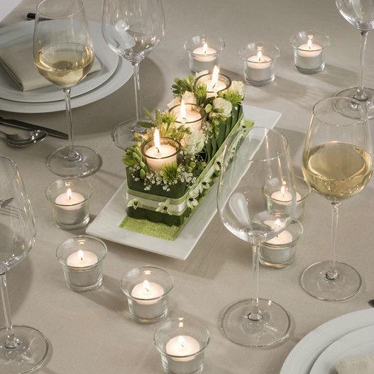 Beispiel: Liebevoll arrangierter Tischschmuck, Foto: BLUMEN STRAUB.