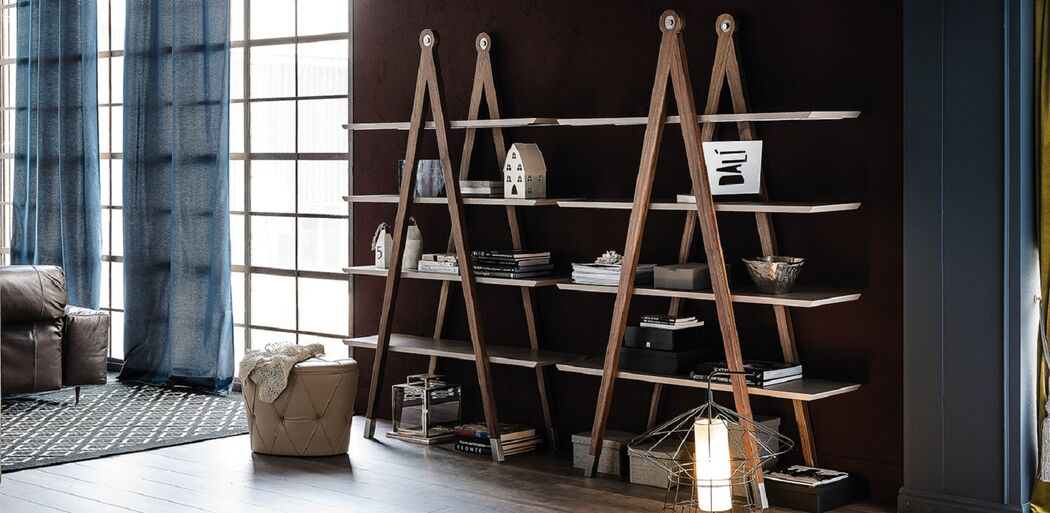 The Giotto library is characterized by a linear design and is enhanced by a painted walnut frame and shelves available in different colors. Modern yet also adaptable to the most classic environments, the number of shelves and generous size make this library a beautiful and functional piece of furniture.
