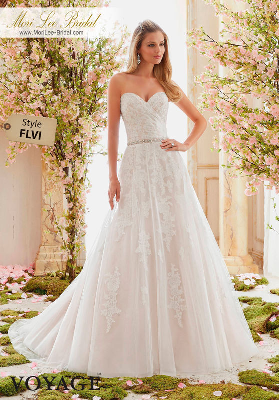 Dress Style FLVI  SOFT TULLE OVERLAYS DELICATELY BEADED ALENCON LACE APPLIQUES  Removable Beaded Satin Belt included. Colors Available: White, Ivory, Ivory/Champagne, Ivory/Blush