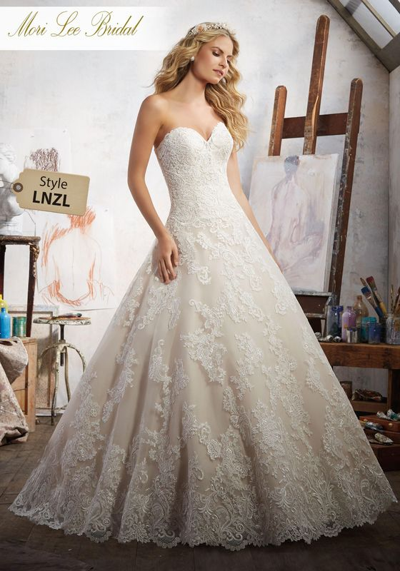 Dress style LNZL Magdalena Wedding Dress Available in Three Lengths: 55″, 58″, 61″. Colors Available: White, Ivory, Ivory/Champagne. Shown in Ivory/Champagne.