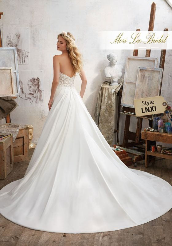 Dress style LNXI Mara Wedding Dress  Colors Available: White, Ivory, Ivory/Nude. Shown in Ivory/Nude.