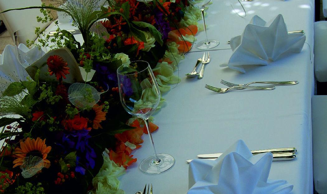 Beispiel: Tischdekoration, Foto: Blumen Komander.