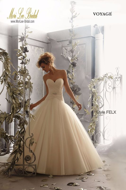 Dress Style FELX Tulle Wedding Gown  Removable Beaded Satin Tie Sash included. Sash also sold separately as Style #11068. Colors Available: White, Ivory, Champagne. Sizes Available: 2-28