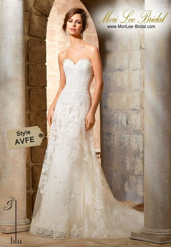 Dress Style AVFE Elegant Alencon Lace Appliques On Soft Net Gown With Scalloped Hemline Lace  Exquisite patterns of Alencon lace adorn the decadent bodice of this A-line wedding dress, complete with a full Net over-skirt, edged in lace. Accented with a stunning sweetheart neckline, and finished with covered button detail along the back. Available in Three Lengths: 55