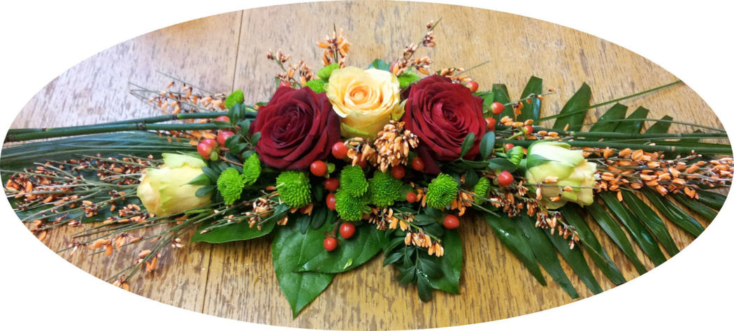 Beispiel: Tischgesteck, Foto: Blumen Reichert.