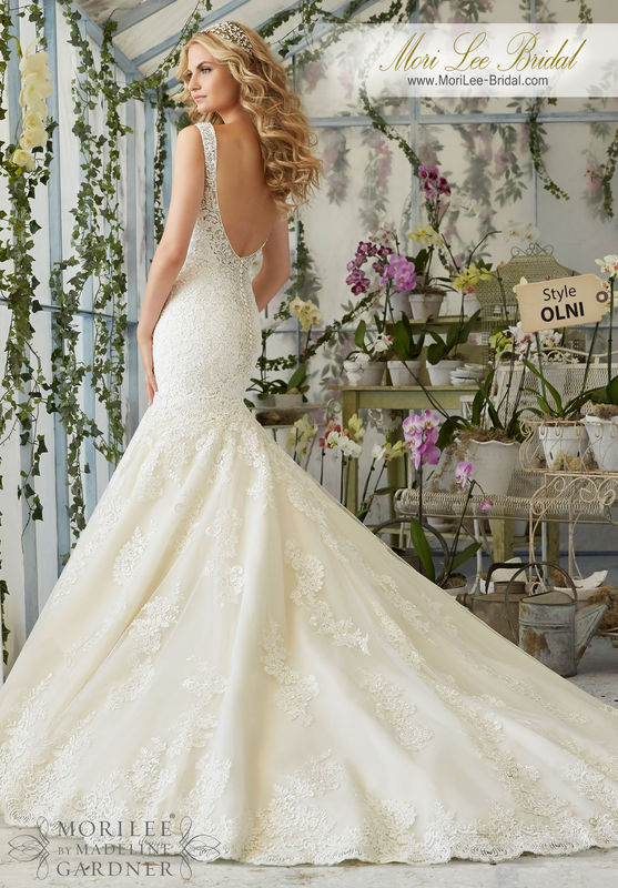 """Dress Style OLNI Crystal Beaded Embroidery Cascades Onto The Tulle Gown With Alencon Lace Appliques And Scalloped Hemline  Available in Three Lengths: 55"""", 58"""", 61"""". Colors Available: White/Silver, Ivory/Silver, Light Gold/Silver."""
