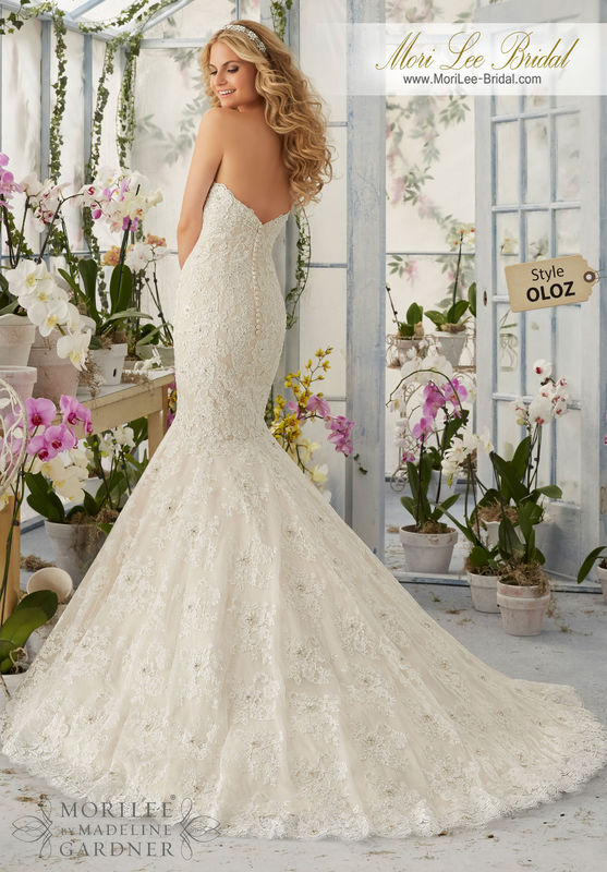 """Dress Style OLOZ Allover Alencon Lace, Mermaid Gown With Delicate Pearl And Crystal Beading And Scalloped Hemline  Available in Three Lengths: 55"""", 58"""", 61"""". Colors available: White, Ivory, Ivory/Light Gold, Ivory/Blush."""