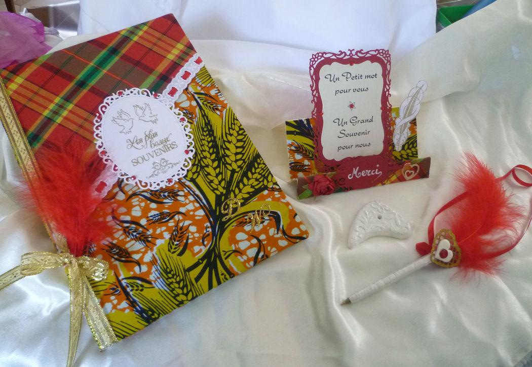 livre d'or et remerciements, stylo assorti sur le thème AFRIQUE et ANTILLES rouge urne assorti et coussin sur demane