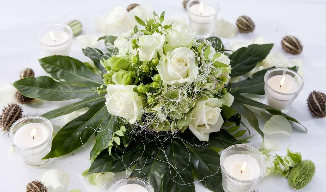 Beispiel: Blumengesteck, Foto: 1A Blumen Halbig.