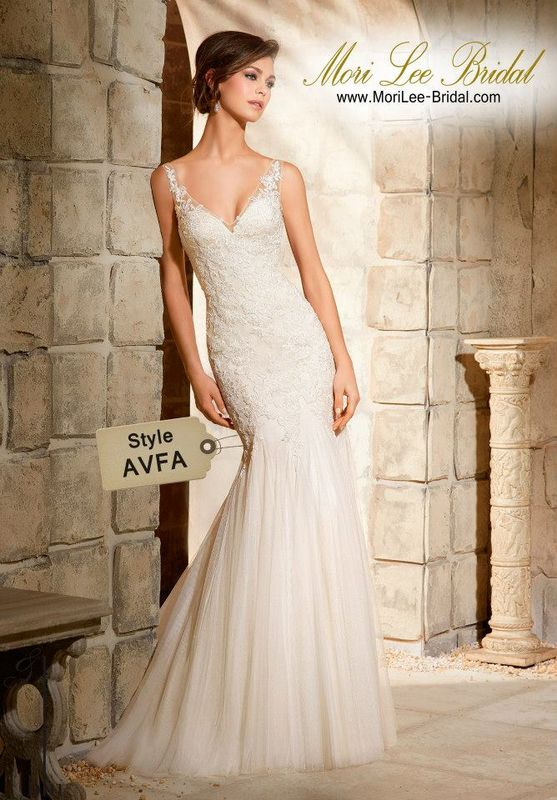 Style AVFA Embroidered Appliques On Soft Net Gown  Delicate and ethereal, this sheath gown is the true definition of femininity and romance. The Deep V neckline is trimmed in soft Net and dainty floral appliques, creating a beautiful illusion effect that continues on to the Deep V back. Colors Available: White, Ivory, Light Gold