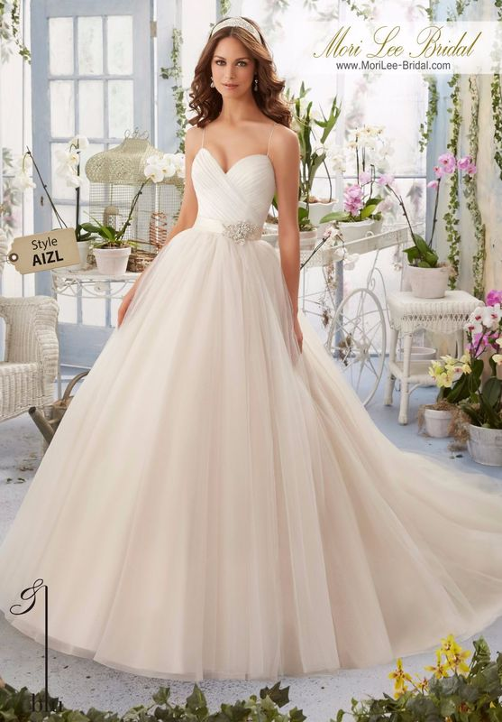 Dress Style AIZL Asymmetrically Draped Bodice With Shoestring Straps Onto The Tulle Ball Gown  Removable Satin and Organza Tie Sash with Diamante Beaded Lace Applique. Colors Available: White, Ivory, Ivory/Light Gold, Ivory/Blush.