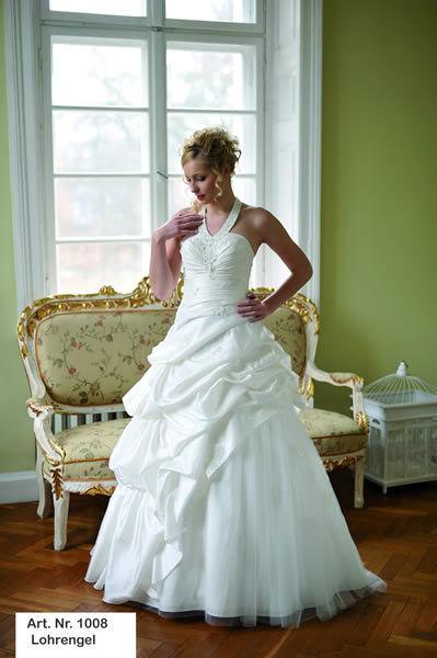 Beispiel: Wunderschöne Brautkleider, Foto: Minder Mode.