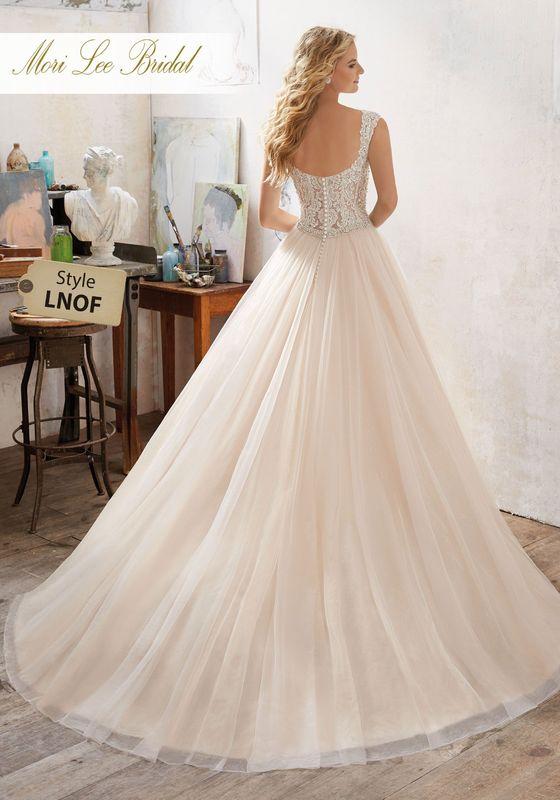 Dress style LNOF Marigold Wedding Dress Colors Available: White, Ivory, Ivory/Caramel. Shown in Ivory/Caramel.