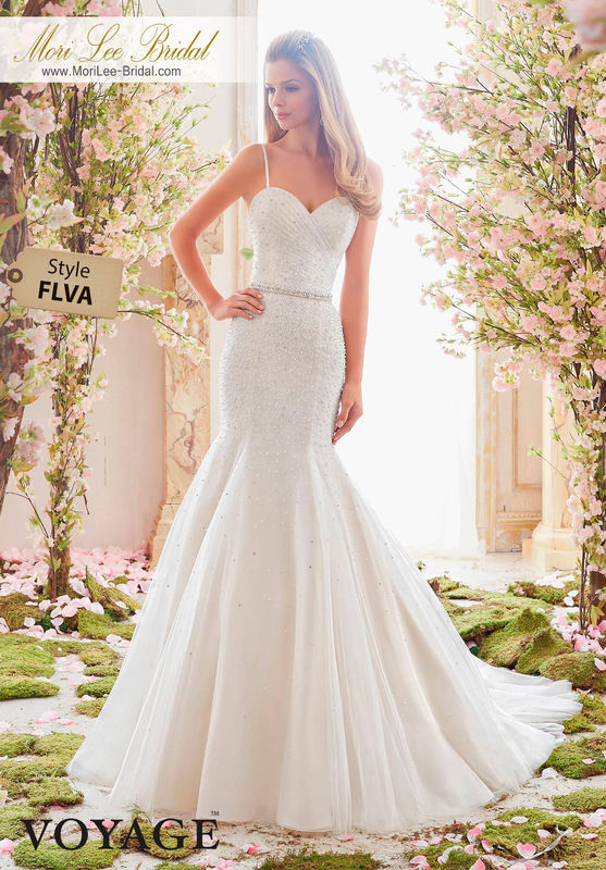 Dress Style FLVA  PEARL AND CRYSTAL BEADING ON SOFT TULLE  Removable Beaded Satin Belt included. Colors Available: White, Ivory, Ivory/Light Gold