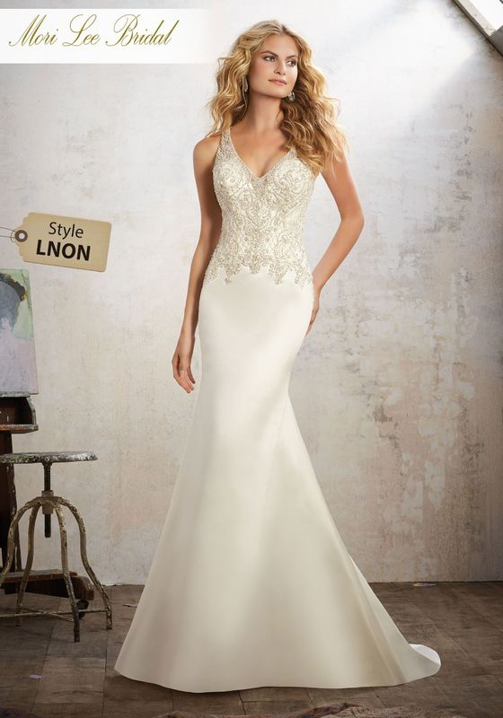 Dress style LNON Maria Wedding Dress Colors Available: White/Silver, Ivory/Silver. Shown in Ivory/Silver.
