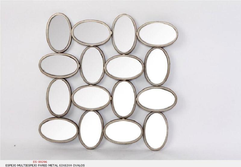 Espejos de metal, con formas muy originales.  Goyart