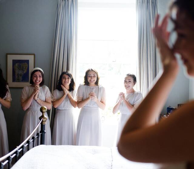 Bridesmaids gets their first look at the bride