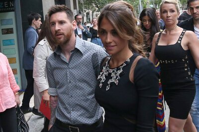 Lionel Messi and Antonella Roccuzzo arrive for a commercial event in Barcelona, Spain May 17, 2017. REUTERS/Albert GeaCODE: X01398