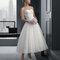 Suknia ślubna do łydki z odkrytymi ramionami, Foto: Rosa Clará 2015