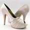 Zapatos blancos estilo peep toe para novias con mucho estilo. Diseño de Adriana Capasso