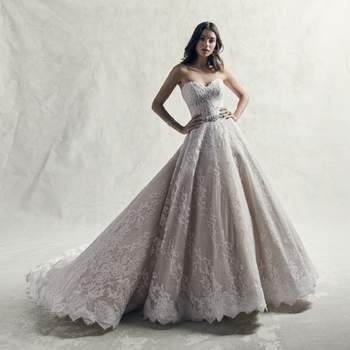 Romantic lace motifs glide over tulle in this breathtaking ballgown princess wedding dress, accenting the strapless sweetheart neckline and hemline.