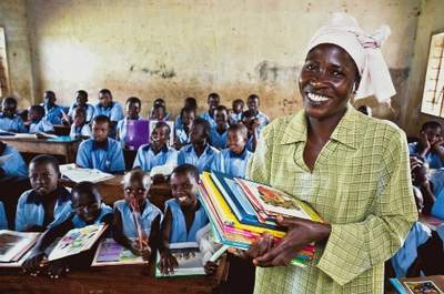 Classroom with children and teacher - Katwe Primary School. Peruth Kyolaba, Deputy Headmistress. Note: from WV Canada Project name: Katwe ADP Africa digital color horizontal