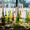 Decoracion de botellas de vidrio con velas. Credits: La Sastreria de las Flores