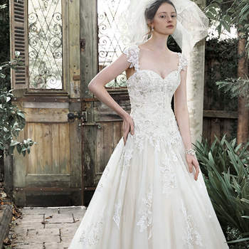 "Elegance and romance combine to create this dreamy ball gown. Exquisite lace, accented with pearl embellishments, adorns a fitted bodice before flaring into a voluminous tulle skirt, edged in delicate lace. Complete with sweetheart neckline, optional lace cap-sleeves and corset closure.  <a href=""http://www.maggiesottero.com/dress.aspx?style=5MT648"" target=""_blank"">Maggie Sottero</a>"