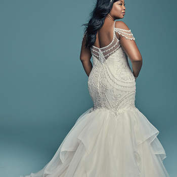 "<a href=""https://www.maggiesottero.com/maggie-sottero/brinkley-lynette/11459"">Maggie Sottero</a>  Glamorous and vintage-inspired, this mermaid wedding dress offers additional coverage to our original Brinkley style. The tulle bodice is accented in beaded embroidery and Swarovski crystals, while beaded illusion cold-shoulder sleeves complete the sweetheart neckline and V-back, also trimmed in beading and illusion. Fit-and-flare skirt comprised of tiered Chic Organza trimmed in horsehair. Finished with crystal buttons over zipper closure."