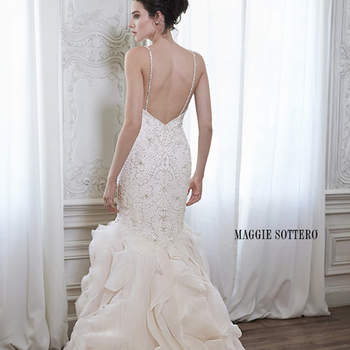 "A swirling cascade of Dione organza adorns this dramatic fit and flare wedding dress, perfect for the modern bride. Complete with sparkling Swarovski crystal bodice, deep sweetheart neckline and dainty beaded spaghetti straps. Finished with zipper back closure.  <a href=""http://www.maggiesottero.com/dress.aspx?style=5MR163"" target=""_blank"">Maggie Sottero Spring 2015</a>"