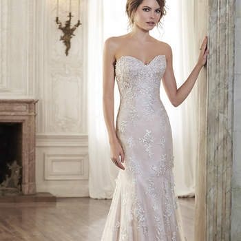 "Timeless romance is found in this A-Line wedding dress featuring a delicate, sweetheart neckline and lace motifs adorning illusion tulle. Finished with covered button over zipper and inner elastic closure.  <a href=""http://www.maggiesottero.com/dress.aspx?style=5MC082"" target=""_blank"">Maggie Sottero Spring 2015</a>"