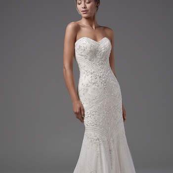"Alluring yet elegant, this strapless, tulle fit-and-flare features shimmering swirls of beaded lace motifs, scoop neckline, and scalloped hem. Complete with crystal buttons over zipper and inner corset closure. Detachable tulle overskirt with beaded waistband sold separately.    <a href=""https://www.maggiesottero.com/sottero-and-midgley/topaz/10254?utm_source=mywedding.com&utm_campaign=spring17&utm_medium=gallery"" target=""_blank"">Sottero and Midgley</a>"