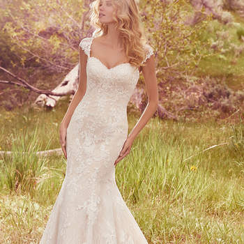 "This romantic fit-and-flare features lace floral appliqués and a strapless sweetheart neckline, complete with exquisite lace hem and delicate beading. Finished with covered buttons over zipper and inner elastic closure. Detachable cap-sleeves with lace appliqués sold separately.  <a href=""https://www.maggiesottero.com/maggie-sottero/jackie/10108?utm_source=mywedding.com&amp;utm_campaign=spring17&amp;utm_medium=gallery"" target=""_blank"">Maggie Sottero</a>"