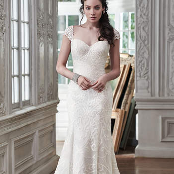 "Timeless and classic, this slim A-line wedding dress is the epitome of beauty with romantic lace and an alluring sweetheart neckline. Available with corset closure or covered button over zipper closure. Detachable cap-sleeves sold separately. <a href=""https://www.maggiesottero.com/maggie-sottero/mirian/9488"" target=""_blank"">Maggie Sottero</a>"