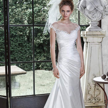 "Demure illusion, accented with lace appliqués, adorns the bateau neckline of this elegant Odara Crepe Back satin A-line wedding dress, with asymmetrical pleated bodice and dramatic illusion back, edged with lace appliqués. Finished with covered buttons over zipper closure.  <a href=""http://www.maggiesottero.com/dress.aspx?style=5MN691"" target=""_blank"">Maggie Sottero</a>"