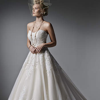 This feminine ball gown features stunning lace appliqués atop ethereal tulle. A subtle scoop neckline, edged in lace, completes the look. Finished with covered buttons over zipper and inner elastic closure. Lace cap-sleeves sold separately.