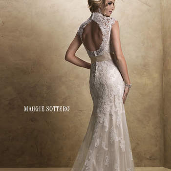 "A dreamy lace and tulle slim line gown with V-neckline and cap-sleeves features a separate slip gown of Vogue Satin to be worn below. The alluring open back is finished with a covered button over zipper closure. Includes a detachable satin ribbon belt.  <a href=""http://www.maggiesottero.com/dress.aspx?style=12623"" target=""_blank"">Maggie Sottero Platinum 2015</a>"