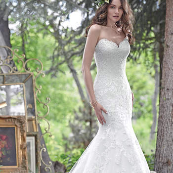 "Elegant and timeless, this fit and flare wedding dress features embroidered lace on tulle and a romantic, scalloped lace sweetheart neckline, creating a show-stopping silhouette. Finished with corset closure. <a href=""www.maggiesottero.com/maggie-sottero/cadence/9539"" target=""_blank"">Maggie Sottero</a>"