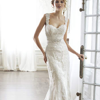 "The pinnacle of romance is found in this streamlined sheath rendered in exquisite lace. Complete with dramatic V-back beautifully detailed with illusion lace, sweetheart neckline and delicate cap-sleeves. Finished with covered button over zipper and inner elastic closure and optional grosgrain ribbon belt with beaded motif. Detachable belt sold separately. <a href=""http://www.maggiesottero.com/dress.aspx?style=5MN083&amp;page=0&amp;pageSize=36&amp;keywordText=&amp;keywordType=All"" target=""_blank"">Maggie Sottero</a>"