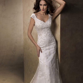 "Defined and demure, this lovely slim A-line gown of tulle and beaded lace motifs features a soft V-neckline, delicate cap-sleeves, and covered button over zipper back closure.   <a href=""http://www.maggiesottero.com/dress.aspx?style=13633"" target=""_blank"">Maggie Sottero Platinum 2015</a>"