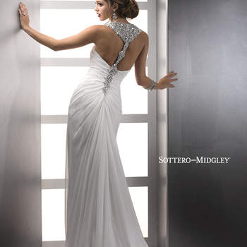 "Sleek and sexy, this slim silhouette of Paris Chiffon shows off a high slit and spectacular, Swarovski crystal encrusted, racer-back shoulder straps and hip embellishment. Finished with zipper back closure.  <a href=""http://www.sotteroandmidgley.com/dress.aspx?style=82503"" target=""_blank"">Sottero &amp; Midgley Platinum 2015</a>"
